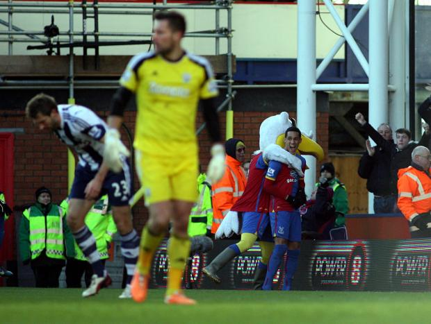 This Is Local London: The Palace mascot congratulates Tom Ince after his opening goal. PICTURES BY EDMUND BOYDEN.
