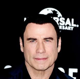 This Is Local London: John Travolta would like to play a Bond villain