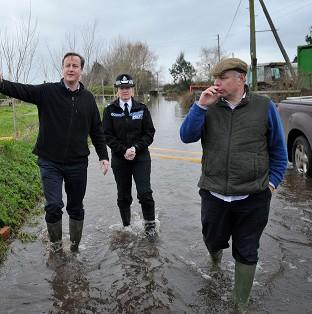 This Is Local London: Prime Minister David Cameron with Bridgwater and West Somerset MP Ian Liddell-Grainger (right) during a visit to Goodings Farm in Fordgate, Somerset