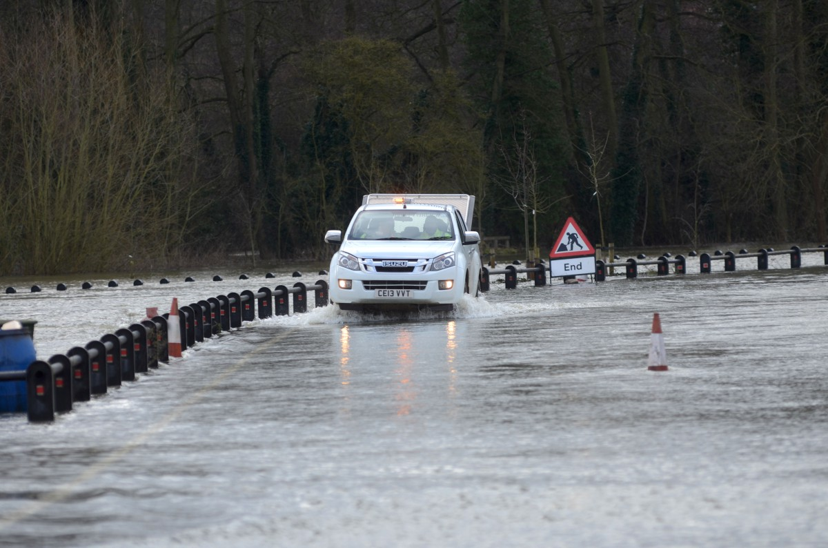 Flooding: The scene near Walton Bridge yesterday