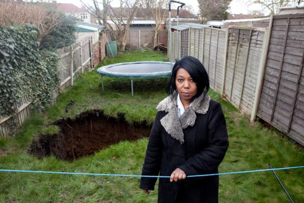This Is Local London: Gretel Davidson, 55, of Holmsdale Grove, Barnehurst, revealed structural engineers have filled the hole with more than 20 tonnes of rubble and 40 tonnes of topsoil.