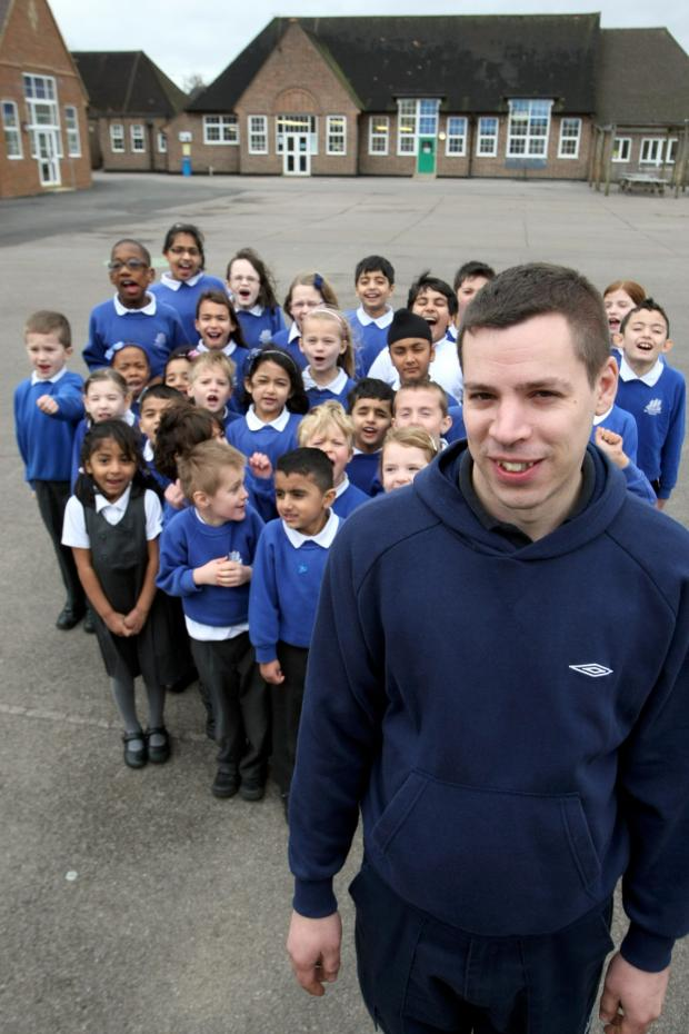 This Is Local London: Full Nelson: Jon Graham with pupils from the school