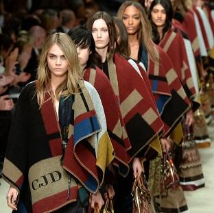 This Is Local London: Cara Delevingne leads out models onto the catwalk during the Burberry show