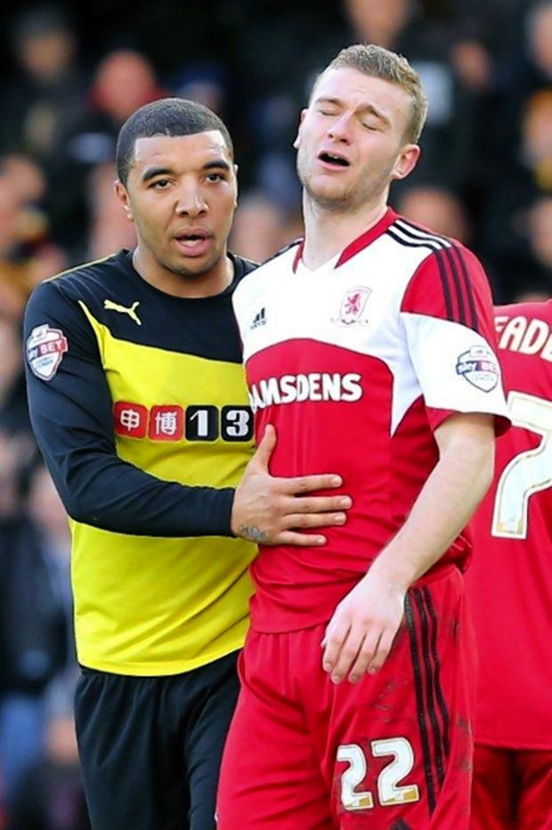 This Is Local London: Watford striker Troy Deeney with Middlesbrough's Ben Gibson, who had just been sent off. Picture: Dave Peters.
