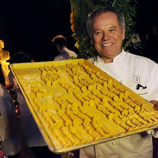 Chef Wolfgang Puck poses with chocolate Oscar statues, which will be served up at this year's