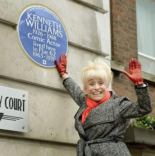 Barbara Windsor with an English Heritage blue plaque for Kenneth Williams