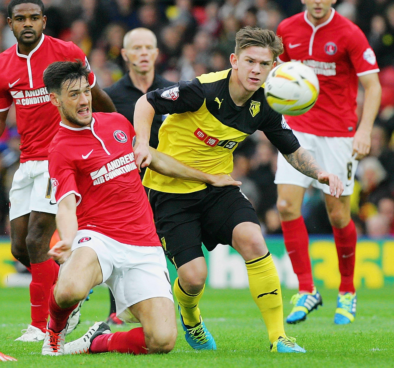 Charlton's Johnnie Jackson up against Watford's Sean Murray earlier this season. Picture: Action Images