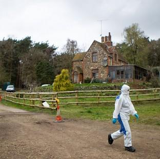 This Is Local London: Police at the scene at Keepers Cottage Stud in Waverley Lane, Farnham, Surrey