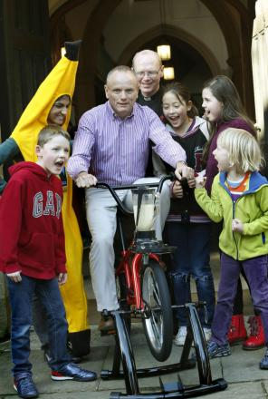Mike Freer MP pedalling the smoothie bike