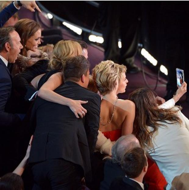 This Is Local London: Kevin Spacey, Angelina Jolie, Julia Roberts, Brad Pitt, Jennifer Lawrence, Ellen Degeneres and Jared Leto join for the Twitter-busting selfie (AP)
