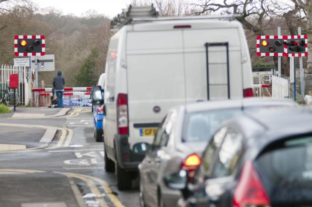 The level crossing in Ashtead often jams and causes traffic chaos