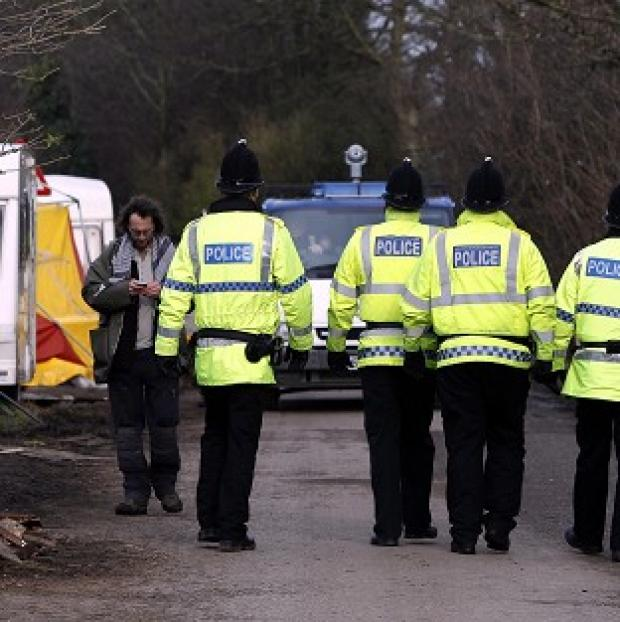 This Is Local London: Police patrol a private road in Barton Moss, Greater Manchester where anti-fracking protestors have set up camp