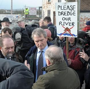 This Is Local London: Environment Secretary Owen Paterson (centre) visiting Northmoor Pumping Station, Somerset, in January