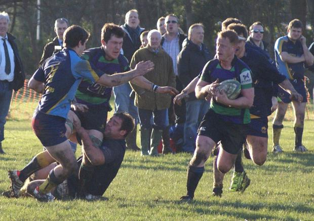 This Is Local London: Running in porridge: Vandals scrum-half John Clark, above, collects a pass from Adam Bullett in Saturday's first match at Brownacres since the floods, right 	Picture: Stuart Amos