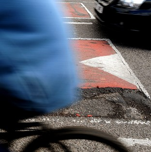 A cyclist died after hitting a pothole