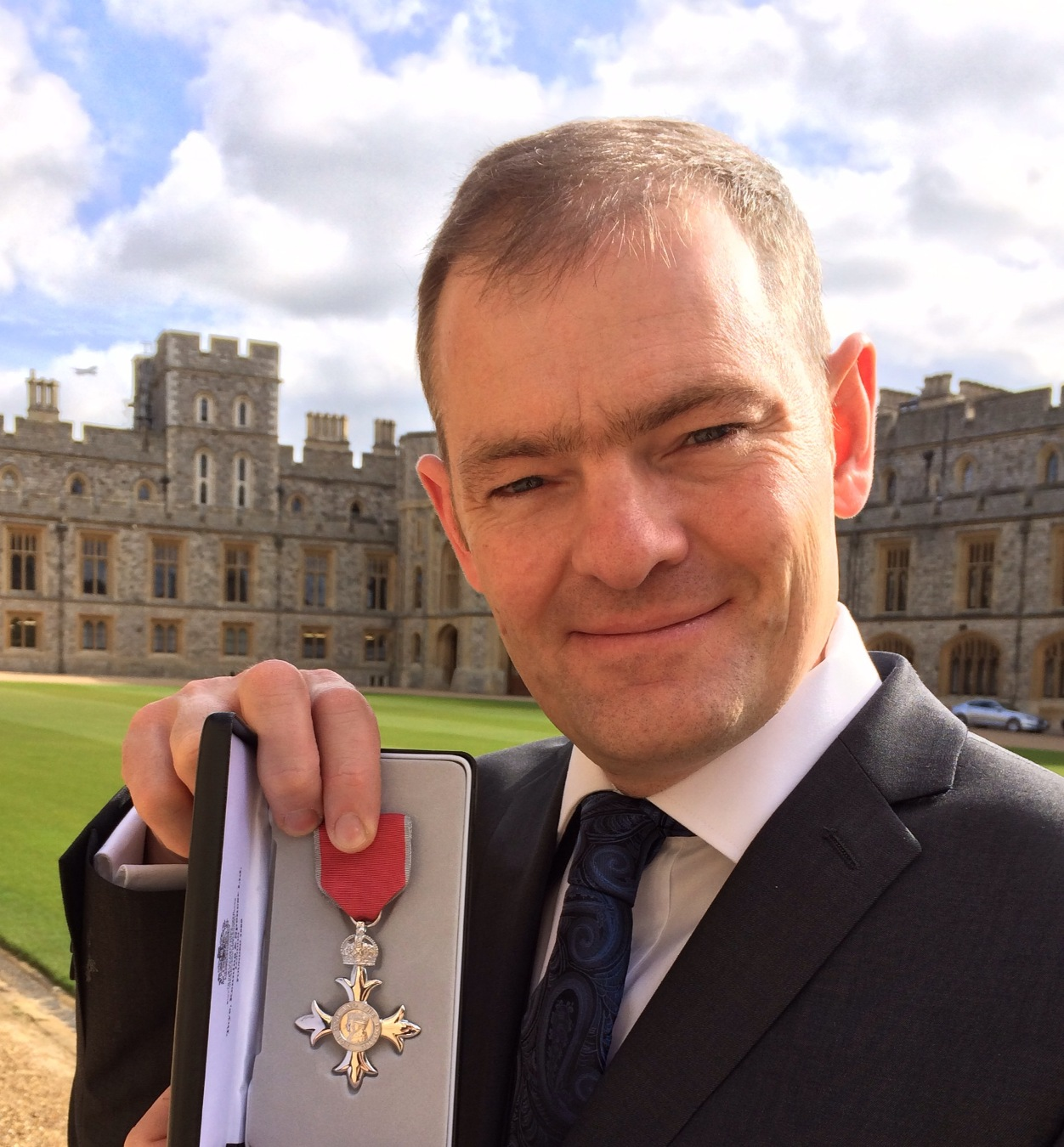 Dr Malcolm Russell was formally invested as a Member of the Order of the British Empire at Windsor Castle after being named in the New Year's Honours List.