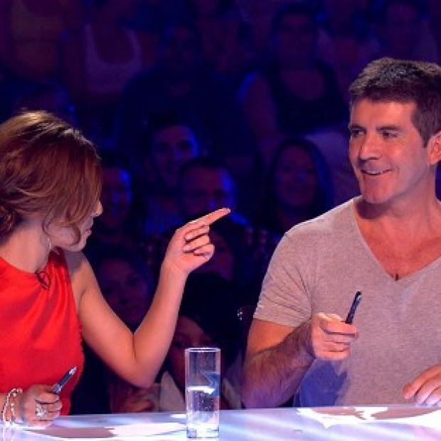 This Is Local London: Cheryl Cole has signed a deal to return as a judge on the new series of The X Factor for a reported �1.5 million