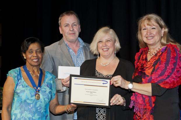 Carers Mark and Paula Hiskey collect their fostering award