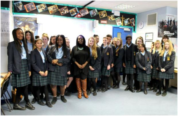 Ruby Mulraine with students at St Catherine's Catholic School