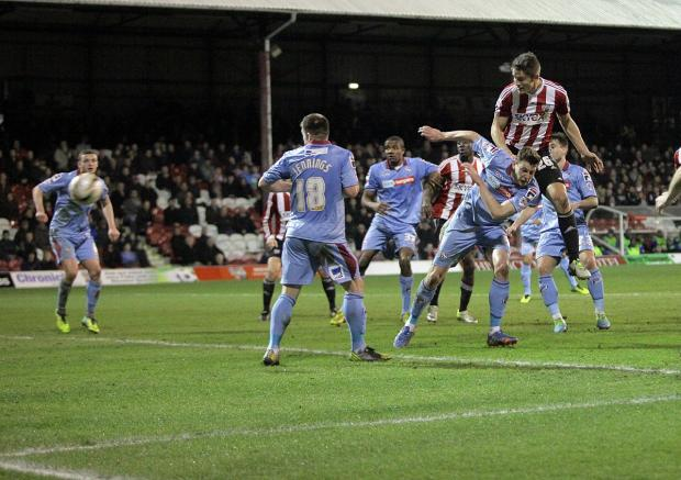 Maiden strike: Brentford's James Tarkowski gets up to head home his first goal for the club on Tuesday against Tranmere Rovers