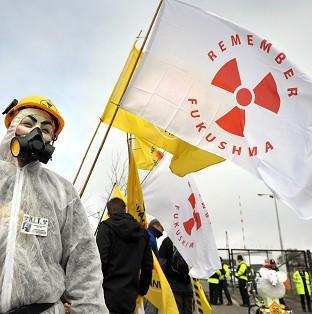 Around 50 people are protesting in London against nuclear power following the third anniversary of the Fukushima disaster