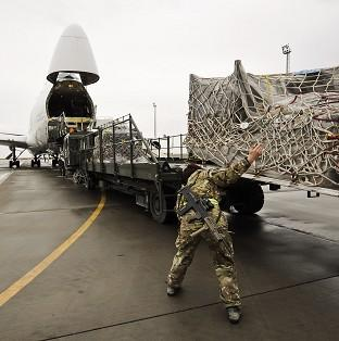 Equipment being loaded into a plane bound for the UK after being recovered from closed down Army bases in