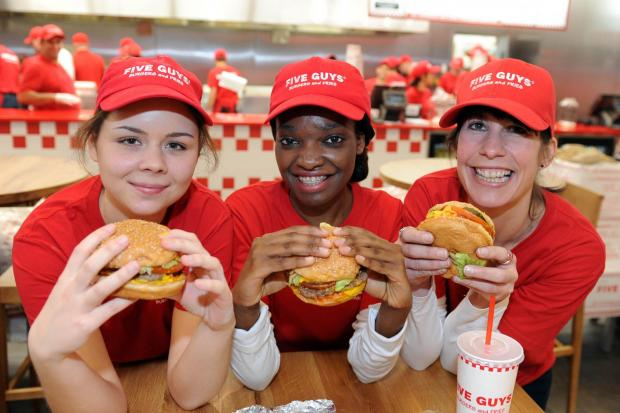 This Is Local London: Indre Sadonyte, Rachael Pedro and Louise Campbell at the new Five Guys restaurant in Kingston