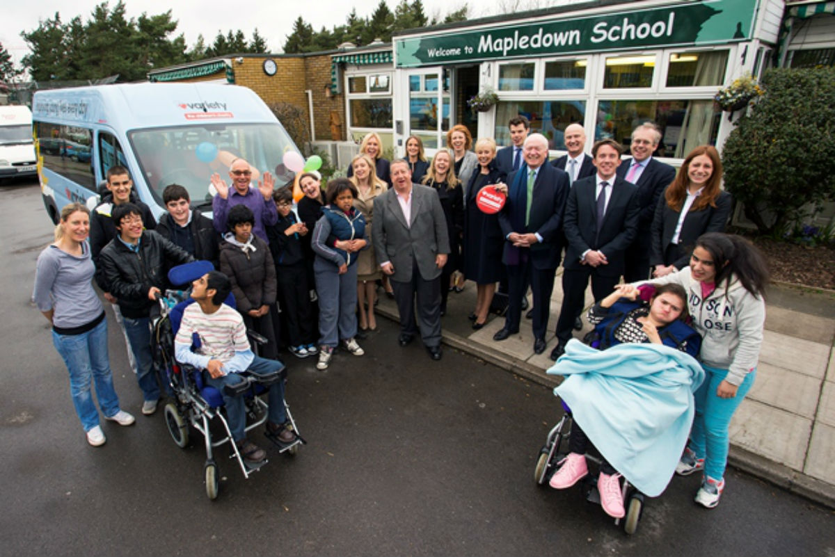 Representatives from Killik & Co presented the new coach to Mapledown School yesterday.