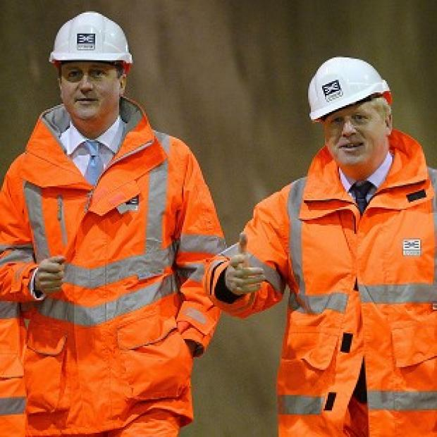 This Is Local London: David Cameron (left) and Boris Johnson visiting a construction site. The PM wants the London Mayor to return to Parliament