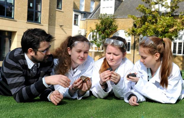 Dr Rob Bastin, Katie Henry, Emma Appleton and Natasha Fisher check out some meteorites