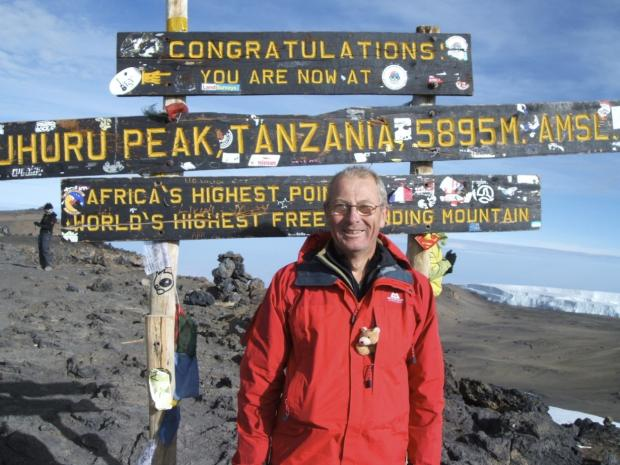 This Is Local London: Peak of condition: Andy James atop Kilimanjaro with his grand-daughter's teddy bear