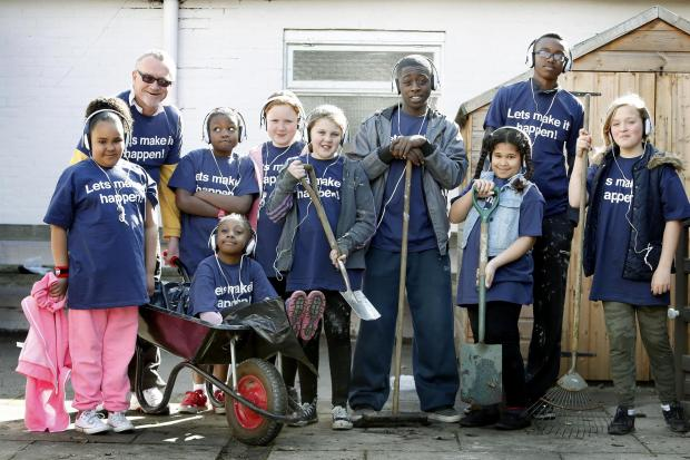 Young volunteers help clear out community centre and gardens