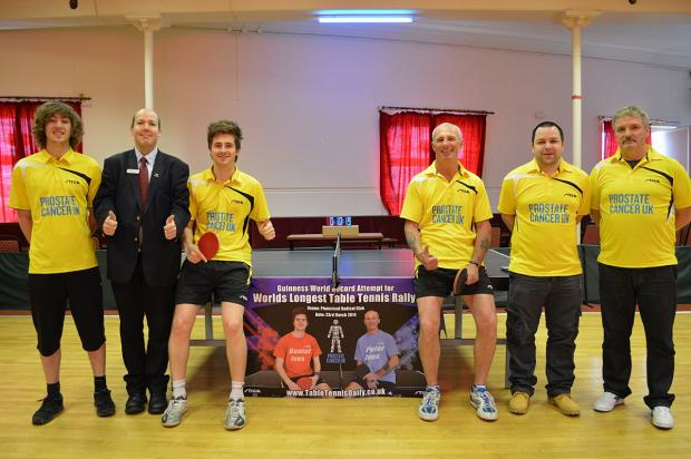 This Is Local London: Daniel Ives, 24, pictured third from left, and Peter Ives, 50, pictured third from right celebrate after breaking the Guinness World Record for the longest table tennis rally