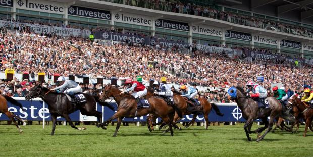 Horses race at the Epsom Derby in front of spectators 2012