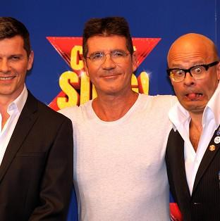 This Is Local London: Nigel Harman (left) will play Simon Cowell (centre) in the musical penned by Harry Hill (right).