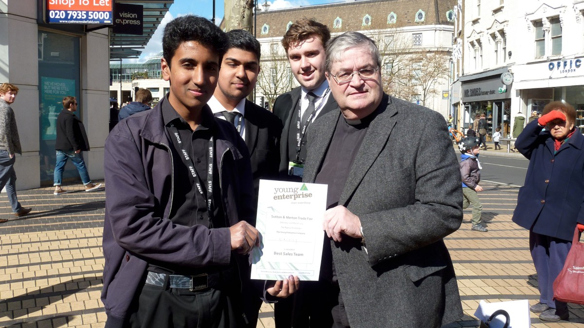 Rev Andrew Wakefield, chair of Merton Chamber of Commerce, with some of the winning students