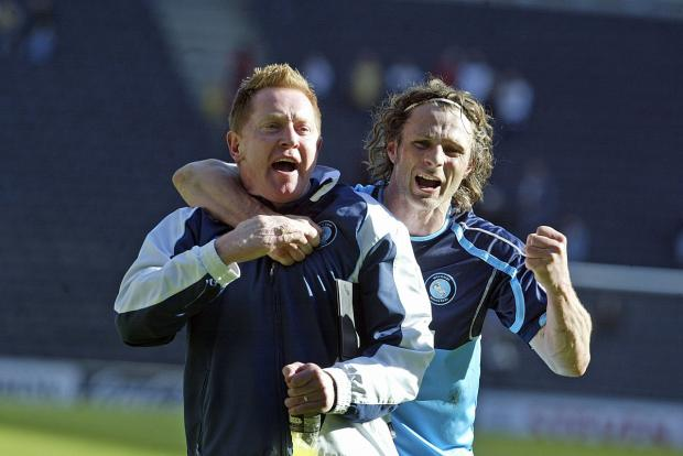 Gareth Ainsworth and Gary Waddock celebrate Wanderers' never to be forgotten win at MK Dons in 2010