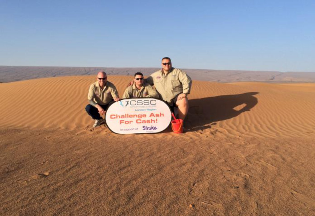 Champions: Ashley Robinson (far right) with fellow trekkers in the Sahara desert