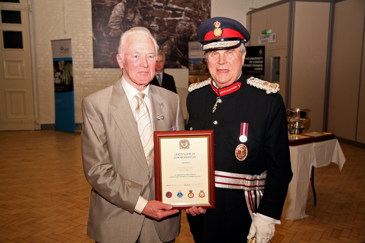 George Glanfield receieves his certificate from Sir David Brewer