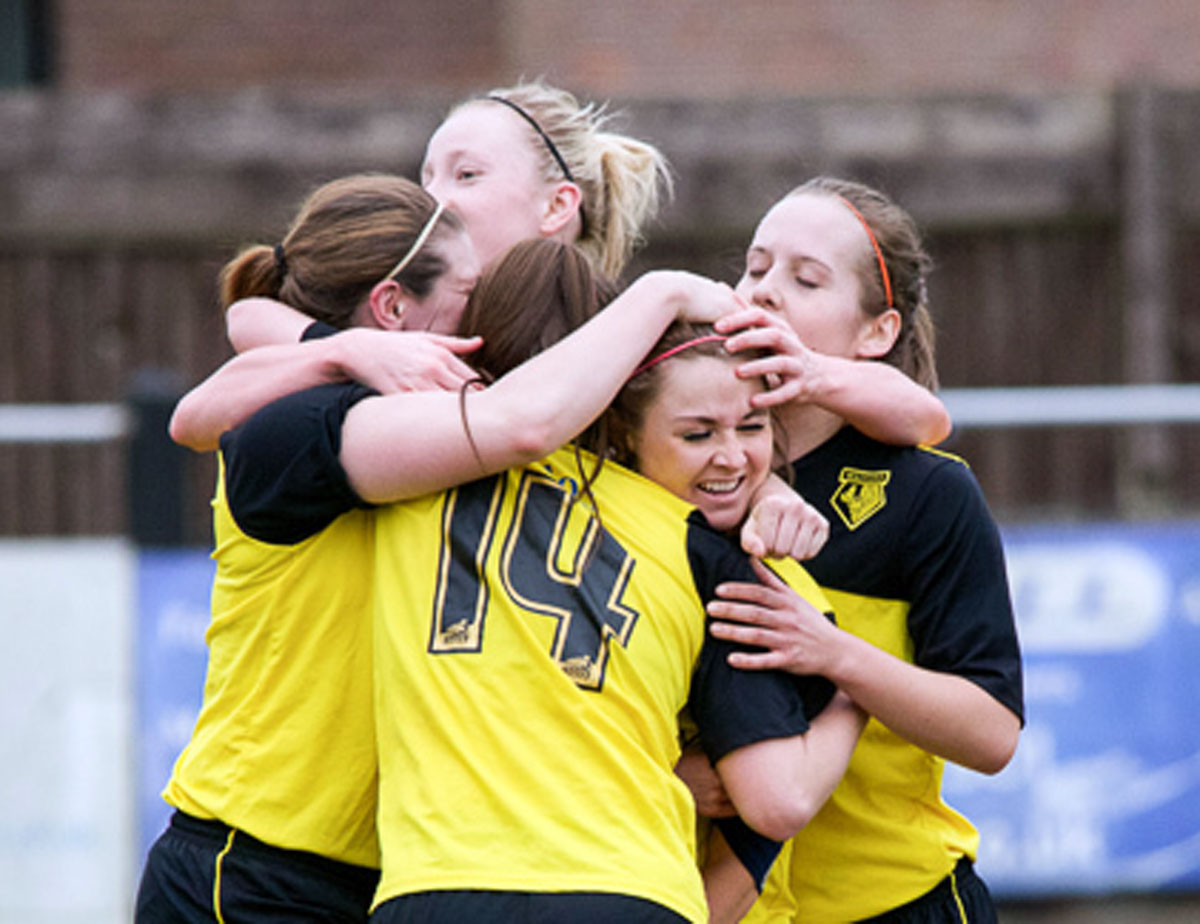 Mobbed: Sarah Wiltshire is congratulated on her goal. Picture: Chris Sutton