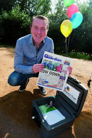 Phil Tufnell with a copy of last week's Epsom Guardian