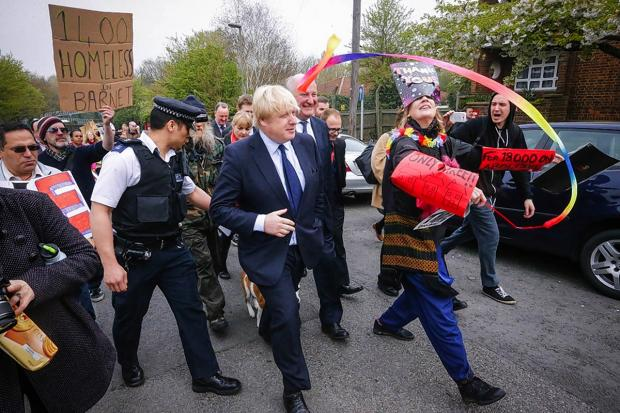 This Is Local London: Protestors wore ironic 'thank you' hats as Boris Johnson arrived in Muswell Hill