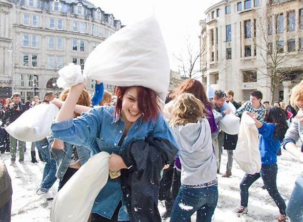 This Is Local London: Pillows at the ready for International Pillow Fight Day. Pic by Chris Beckett via Flickr