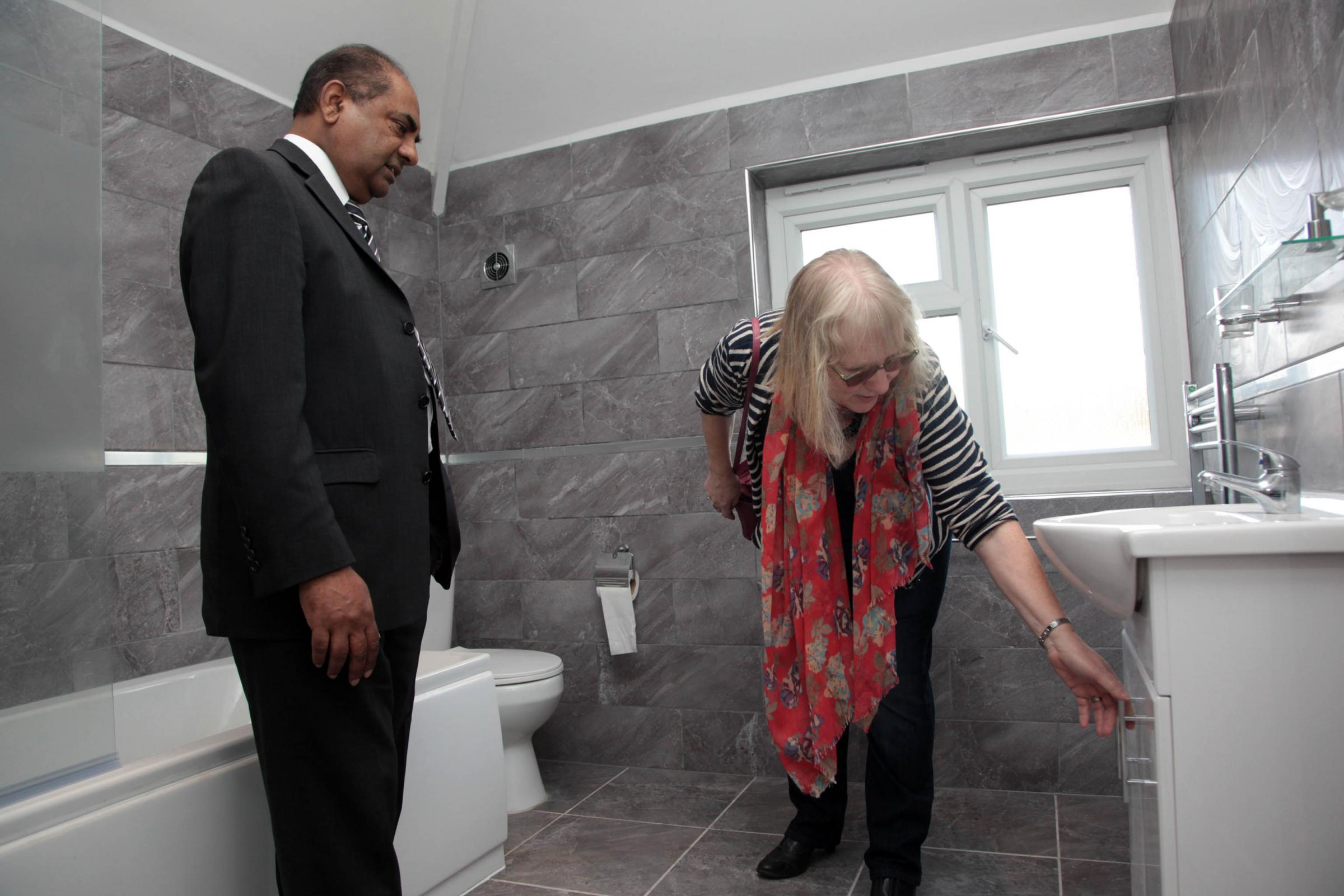 Councillor Patricia Bamford and empty homes officer Mike Patel inspect a newly-renovated house