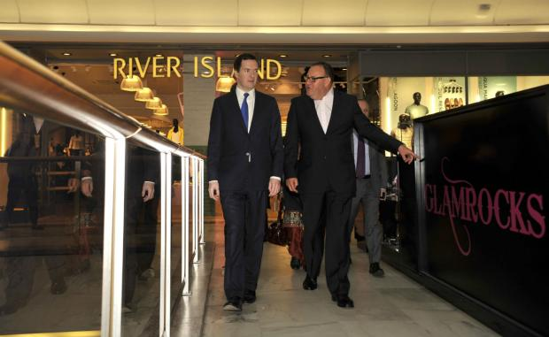 George Osborne takes a tour of Brent Cross Shopping Centre today.