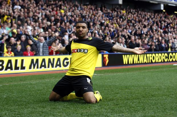 This Is Local London: On his knees in celebration: Troy Deeney after scoring yesterday. Picture: Holly Cant