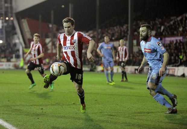 At the double: Bees midfielder Alan Judge scored twice to ensure Brentford returned to winning ways on their return to Griffin Park