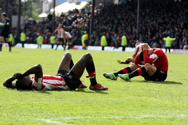 Long memories: Brentford's Clayton Donaldson and Marcello Trotta cannot hide their disappointment after last year's final day defeat to Doncaster Rovers