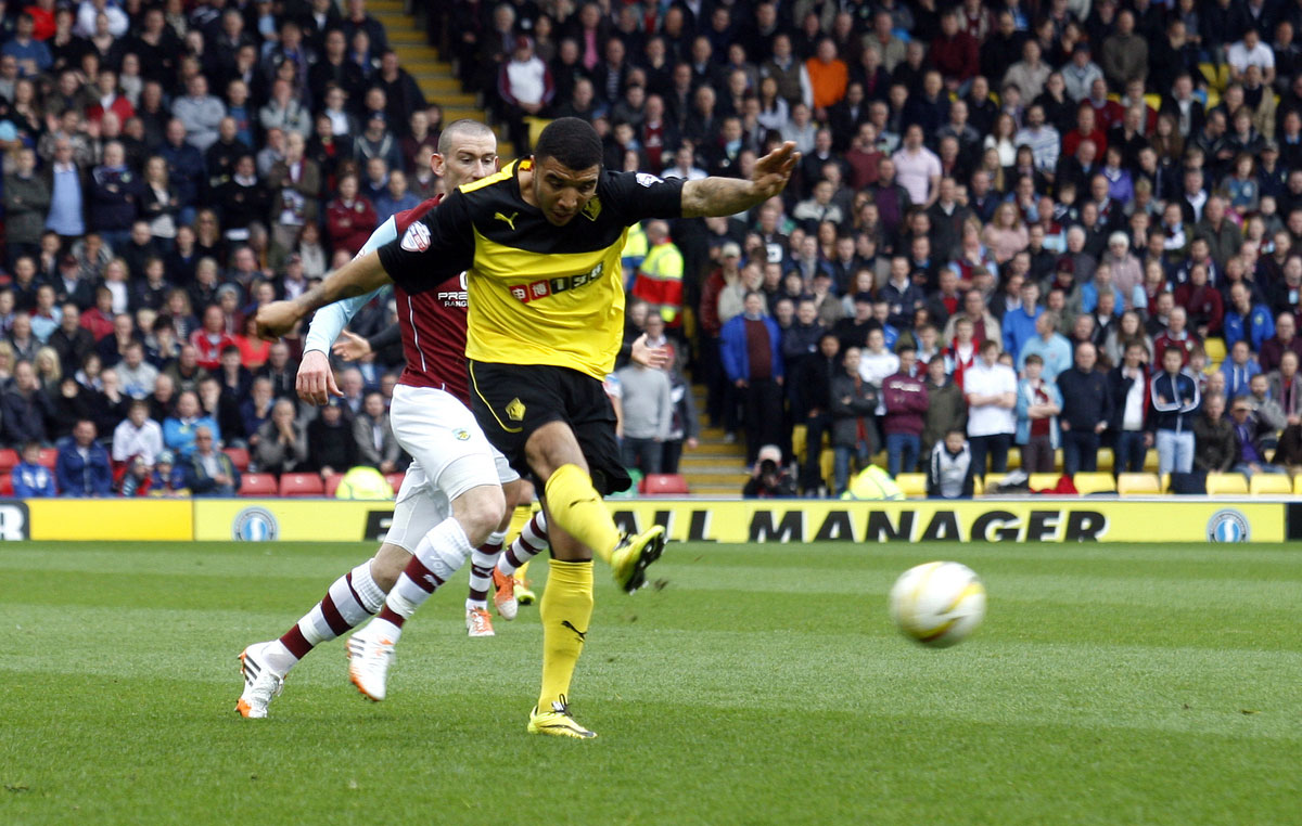 Letting fly: Troy Deeney scoring his fine goal against Burnley on Saturday. Picture: Holly Cant