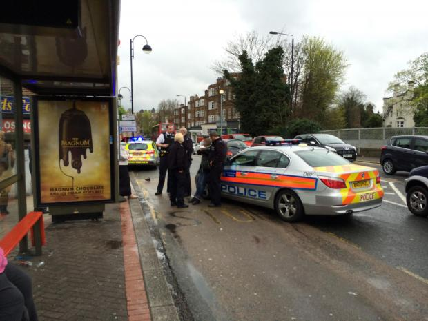 Officers arrested the boy at the bus stop next to Sutton Station